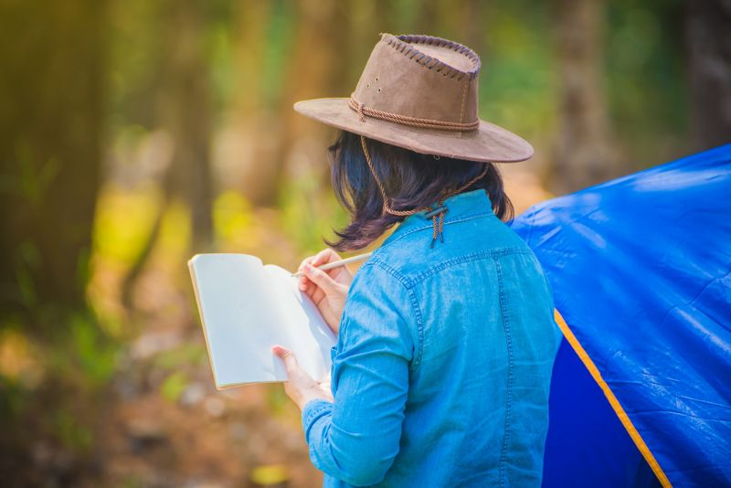 woman-wearing-blue-jean-cowboy-hat | camping for beginners