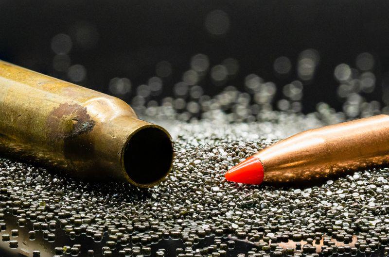 Macro-shot-of-bullet-brass-casing-and-gun-powder   gun ammo