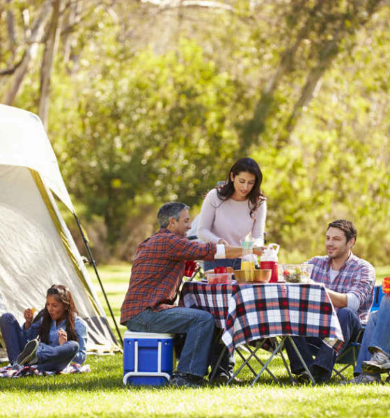 family enjoying camping |Awesome Family Camping Tips For Beginners | Featured